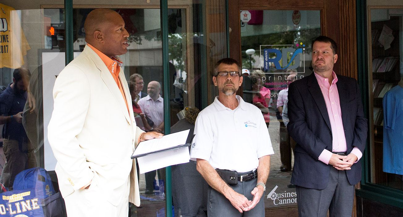 Vice Mayor Alonzo Jones, left, River District Printing owner David Hobson, center, and Maddyzack Des