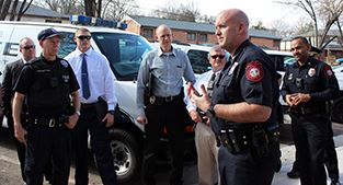 Police Chief Scott Booth speaks to officers before Thursday&#39s first community walk.