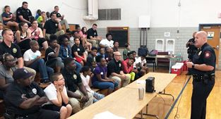 Police chief speaks to kids during first day of academy